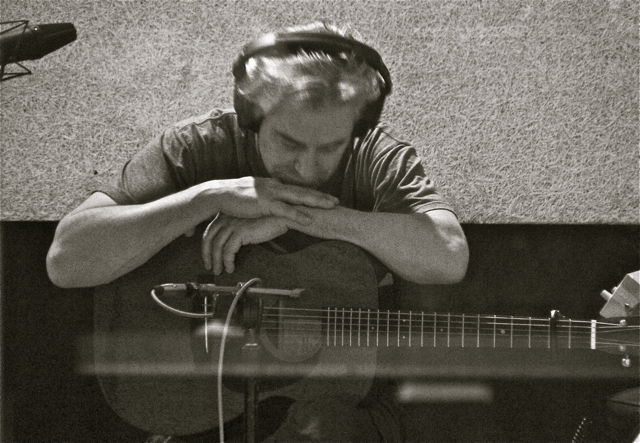"Harding listening to the acoustic guitar playback of ""Stare At The Sun"" in Milkboy Studios, Philadelphia, Jan 2013."