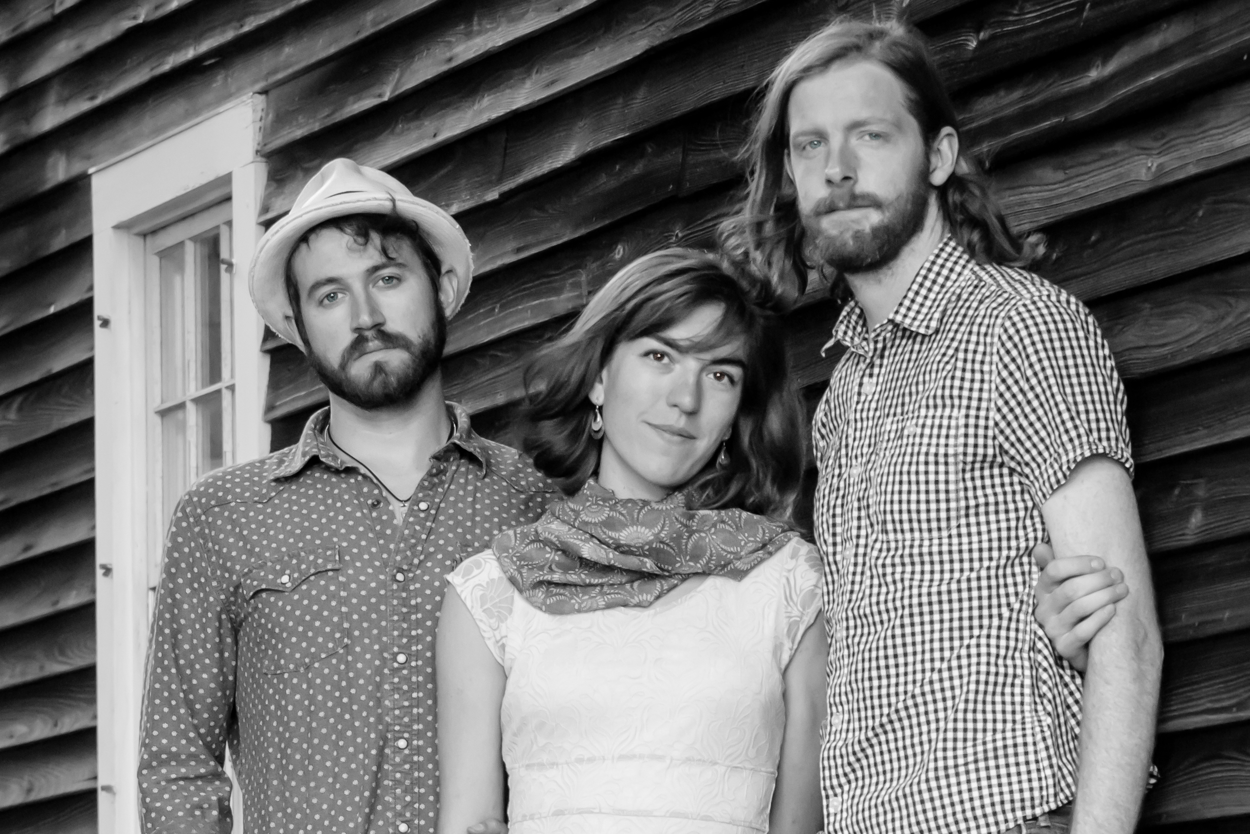 """This is a license granted by Nate Hastings (photographer) to The Stray Birds (band):  This license covers this image of the band captured in Exeter, New Hampshire on June 18, 2016 featuring the band standing beside a barn.  This license grants the band non-exclusive use of this image for use online and in print for paid and unpaid advertising of the band's music, appearances, tours and recordings only.    This license will be active for a period of one year from the date of payment.  It may be renewed, revised or cancelled by mutual agreement between the photographer and the band.  No third-party edits to the image is permitted other than cropping for appropriate sizing for the medium.  No additional uses are permitted without obtaining the photographer's written permission.    Use of images will be credited to """"Nate Hastings"""" whenever practical."""